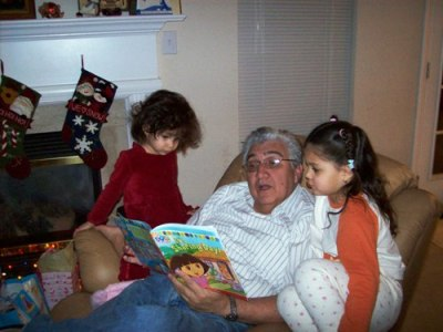 Grandpa Humberto reads the kids a story.