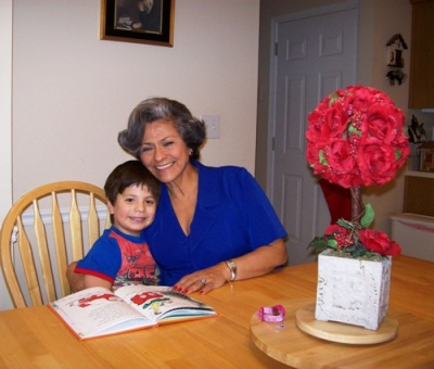 Matthew reads to Grandma Isabel